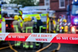 Fire brigade place cordon tape around a suspected arson scene to keep people safe and preserve evidence.