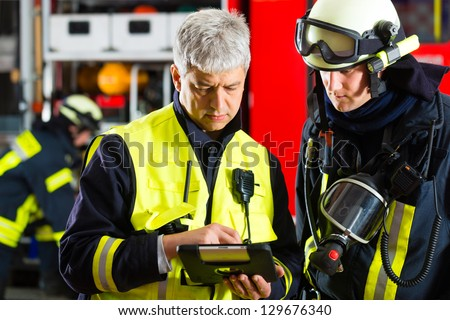 Fire brigade - Squad leader gives instructions, he used the Tablet Computer to plan the deployment