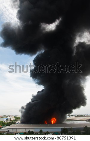Fire burning and black smoke over cargo