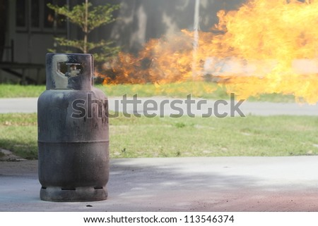 Fire burning over gas container