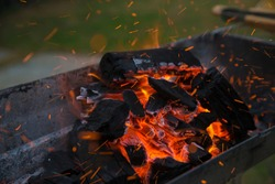 Fire charcoal in stove for cooking and grilling food or barbecue.