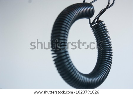 Macro of a copper coils on blue background Images and Stock