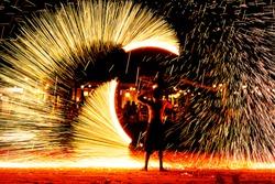 fire dance on beach near the sea , the east coast of thailand