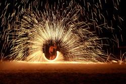Fire dancers Swing fire dancing show, fire show on the beach at Koh Samet, Thailand