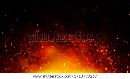 Photo of  Fire embers particles over black background. Fire sparks background. Abstract dark glitter fire particles lights.