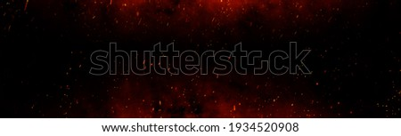 Fire embers particles over black background. Fire sparks background. Abstract dark glitter fire particles lights. bonfire in motion blur. Foto stock ©