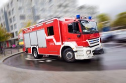 Fire engine driving fast on a road in an emergency