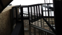 Fire Escape in Dark Alley. Footage. Typical emergency stairs from old building. Fire escape