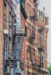 fire escape ladders in narrow alley for Firemen's use only