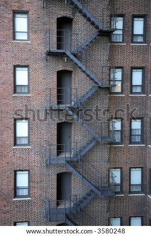 Fire escape on the backside of historic hotel building in downtown Chicago, Illinois, USA