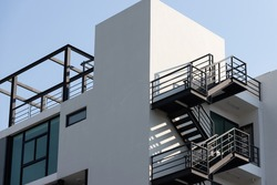 fire escape stair steel. black outdoor metal stair of building.
