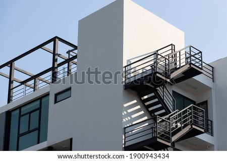 fire escape stair steel. black outdoor metal stair of building. stock photo