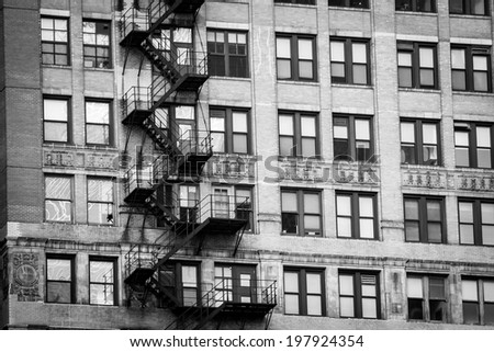 Fire escape stairs on a building in Downtown Chicago, in the Theater District of the Loop, on a gloomy and cloudy day.