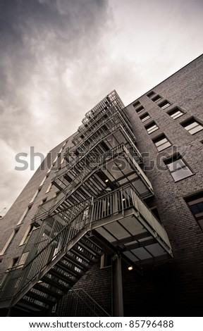 Fire escape stairs on an old building in perspective