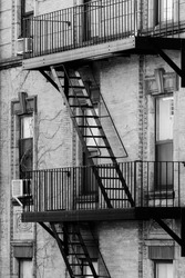 Fire escapes. Design details of Modern and Classic Architecture in Manhattan. Photographed in black and white.