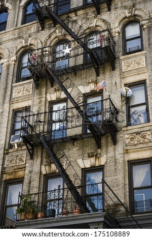 fire escapes on an apartment building in a large city