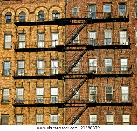 fire escapes on old tenement buildings in boston massachusetts seemingly attaching the buildings together