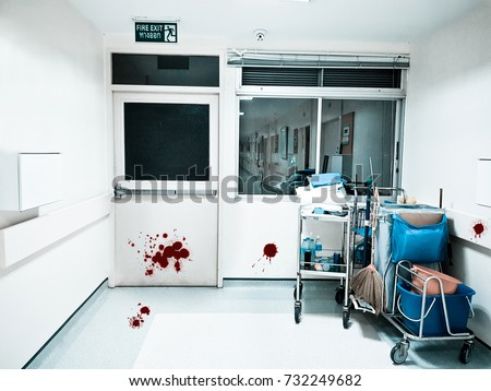 Photo of  Fire exit.Blood stains, doors, walls and floors.Scary mood
