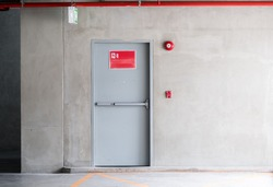 Fire exit door for emergency case of the parking building near the business office.