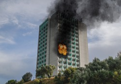 Fire - explosion in the hotel room. Images captured from the outside. Building on fire.