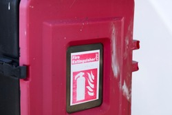 Fire extinguisher red box casing on ferry ship