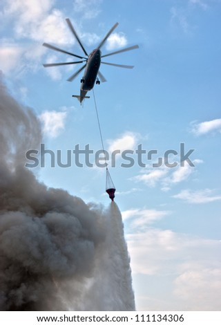 fire extinguishing from the helicopter - stock photo