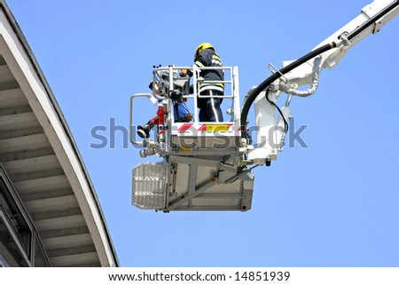 Fire fighter in big and tall crane