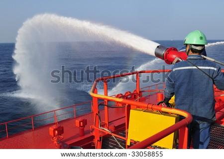 Fire fighting foam/water gun onboard of tanker ship - stock photo