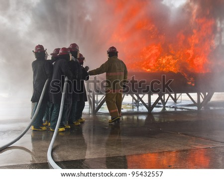 Fire fighting team training with real fire