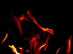 Fire flame burn glowing on black background, beautiful abstract fire blazing to orane and red flame show high and power energy, photo beauty for graphic creative design fire wallpaper and pattern