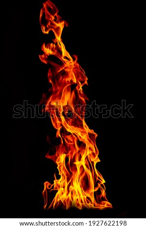 Fire flame isolated on black isolated background - Beautiful yellow, orange and red and red blaze fire flame texture style. Foto stock ©
