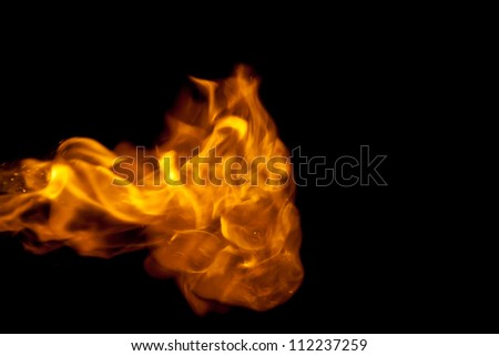 Fire flames against a black background