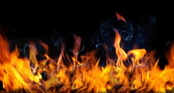 Fire flames and Smoke on black color background . Image of burning fire for decorative special effect .