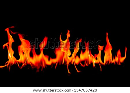 Fire flames on Abstract art black background, Burning red hot sparks rise, Fiery orange glowing flying particles #1347057428