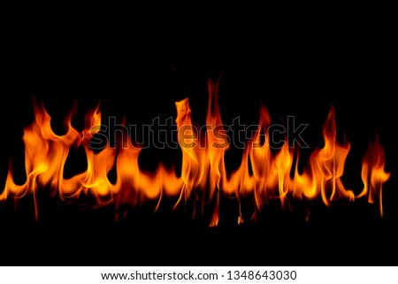 Fire flames on Abstract art black background, Burning red hot sparks rise, Fiery orange glowing flying particles #1348643030
