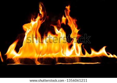 Fire flames on Abstract art black background, Burning red hot sparks rise, Fiery orange glowing flying particles #1356061211