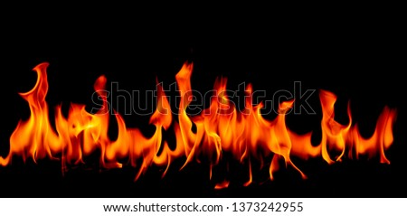 Fire flames on Abstract art black background, Burning red hot sparks rise, Fiery orange glowing flying particles #1373242955
