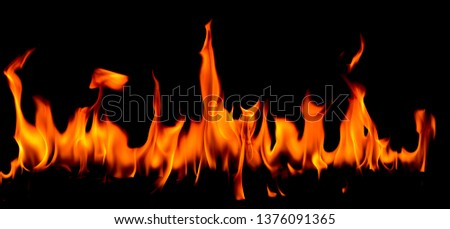 Fire flames on Abstract art black background, Burning red hot sparks rise, Fiery orange glowing flying particles #1376091365