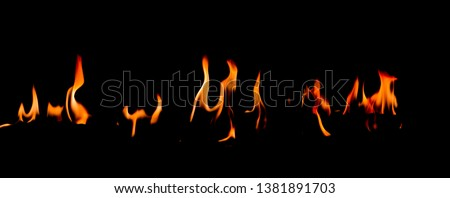 Fire flames on Abstract art black background, Burning red hot sparks rise, Fiery orange glowing flying particles #1381891703
