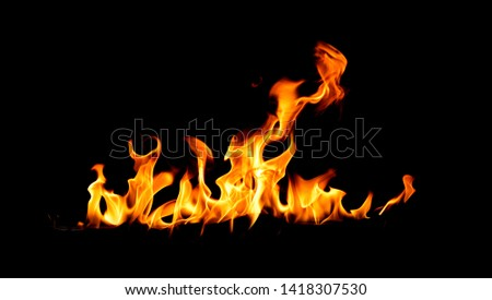 Fire flames on Abstract art black background, Burning red hot sparks rise, Fiery orange glowing flying particles #1418307530