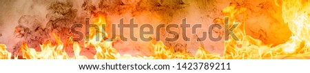 Fire flames on Abstract art black background, Burning red hot sparks rise, Fiery orange glowing flying particles #1423789211