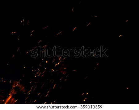 Stock Photo fire flames with sparks on a black background
