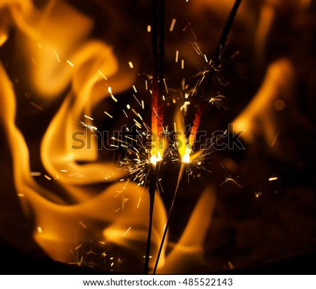 fire flames with sparks on a black background #485522143