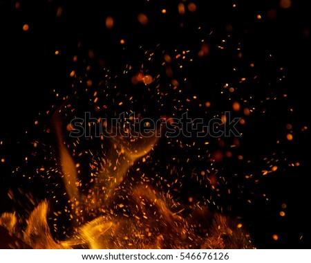 Photo of  fire flames with sparks on a black background