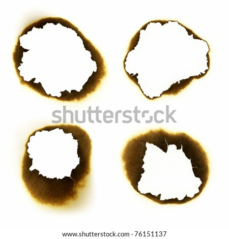 Fire holes in white paper