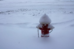 Fire hydrant covered with snow during snow storm