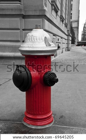 Fire hydrant in the street of New York City. B/W picture with red hydrant.