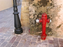 Fire hydrant on street. Element of fire safety system of city.