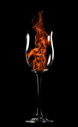 fire in a glass on a black background