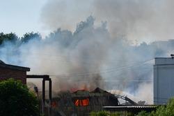 Fire in an industrial building. Fire in a hangar. Fire in a warehouse. Fire in a city.